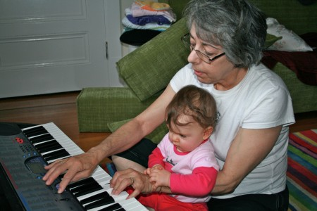 Grandma Judy and Isadora playing keyboards
